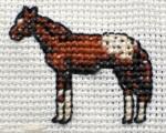 im Kreuzstich gesticktes Westernpferd